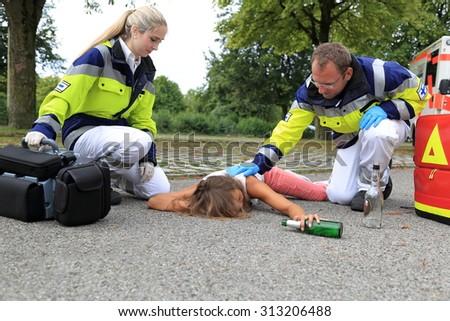 A Teenager drunken on floor with paramedic Сток-фото ©