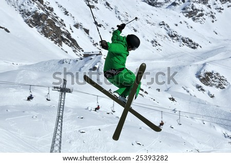 a Tele-hele. A skier executes a perfect crossed skis tele-heli during a high jump