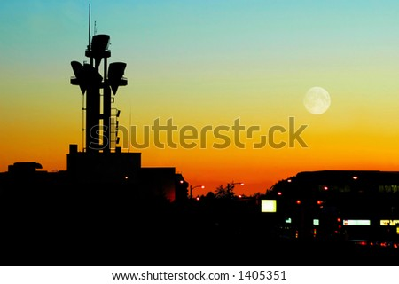 A telecommunications tower antenna at dusk