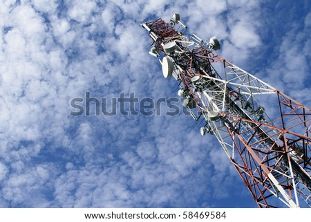 A telecommunications tower with dramatic clouds
