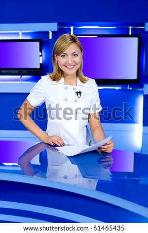 a television anchorwoman at studio, looks into camera