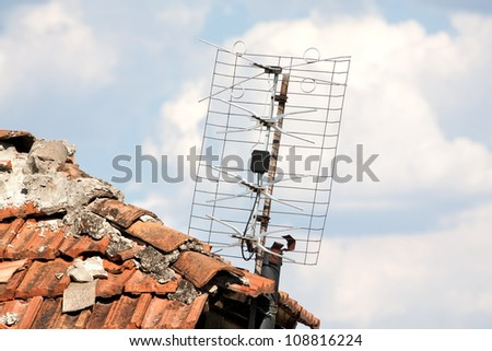 A television antenna on the roof of the old.