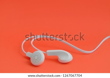 A template for music listening fans. White earphones on red
