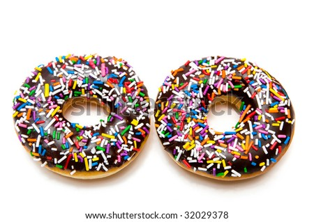 A tempting donuts with chocolate icing and colorful sprinkles, isolated on a pure white background.