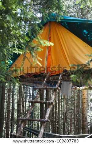 A tend in a scout camp in the Alps - stock photo