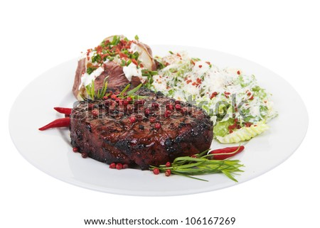 A tenderloin steak dinner isolated on white background
