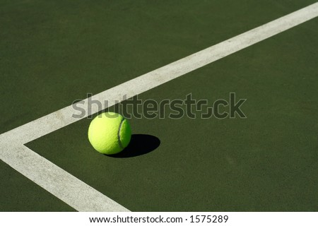 A tennis ball in a tennis court