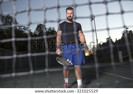 A tennis player having fun to play