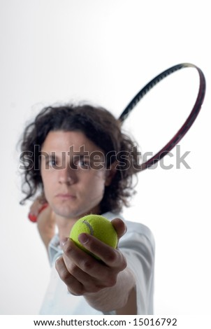 A tennis player ready to serve the tennis ball. Vertically framed shot