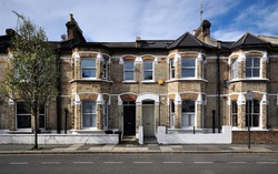 A terrace of Victorian period houses in west London, UK.