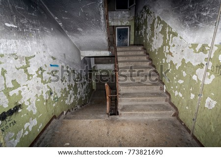 "A terrible interior of an apartment building with cheap apartments. Typically, residents of such buildings are poor people. This type of building is called a ""gostinka"". Russia, Vladivostok. #773821690"