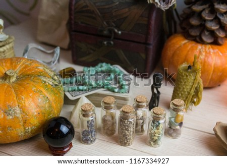 A test tube with seeds and stones, pumpkin and crystals, witchcraft, Wicca #1167334927