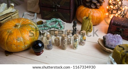 A test tube with seeds and stones, pumpkin and crystals, witchcraft, Wicca #1167334930