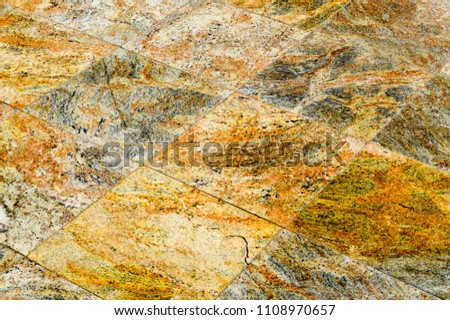 A texture of rhombuses made of stone ceramic granite brown beautiful expensive tiles. The background. #1108970657
