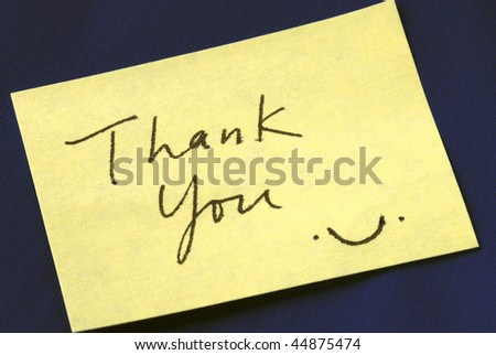 A Thank You note isolated on dark blue background