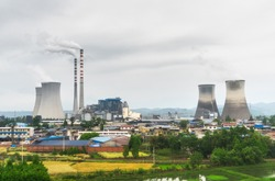 a thermal power plant that is emitting soot