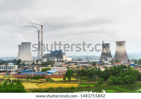 a thermal power plant that is emitting soot #1483755842