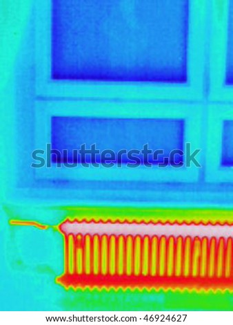a thermography or thermal image of a room with a window and a radiator