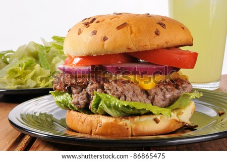 A thick cheeseburger made from organic grassfed beef