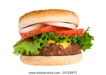 A thick, fresh and juicy hamburger with all the trimmings isolated on white.