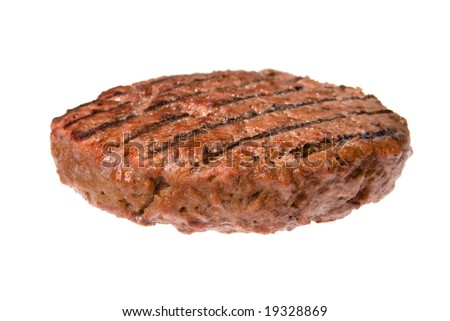 A thick, juicy hamburger patty cooked on a barbecue isolated on white.