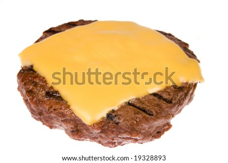 A thick, juicy hamburger patty with a melted slice of cheese freshly cooked on a barbecue and isolated on white.