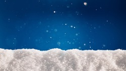 A thick layer of snow on blue background. Winter holidays background with snow texture
