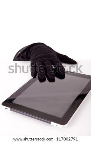 A thief stealing a tablet computer - piracy concept