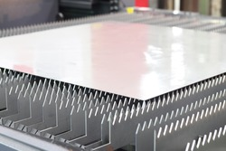 A thin steel sheet locate on laser cutting machine table