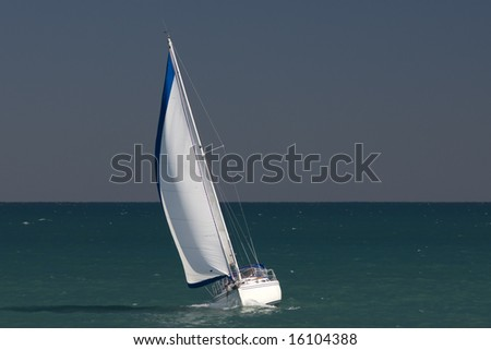 A thirty foot sailboat tacking in heavy wind on Lake Michigan