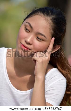 A Thoughtful Beautiful Minority Female