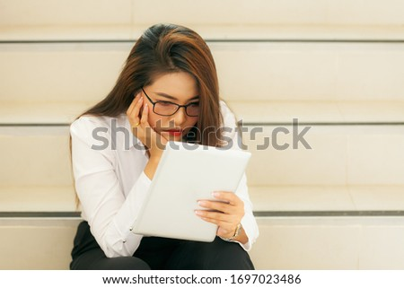 A thousand-year-old sad woman sitting at work or at home. Covering the face with hands The female worker felt unhealthy headaches or eye pain. Businesses have problems receiving bad news concepts.
