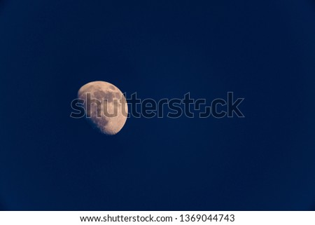 A three quarter moon photographed in the northern hemisphere