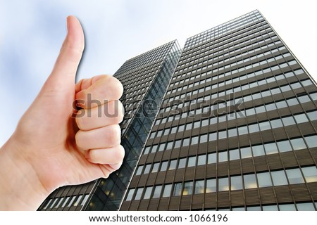 A thumbs up and a tall business building.  Success in Business