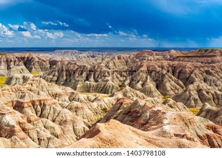 A thunderstorm inside Badlands national park with the rock formations illuminated by sunlight, Rapid City, South Dakota, USA. Photo stock ©