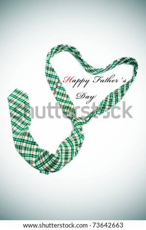 a tie forming a heart and the sentence happy fathers day