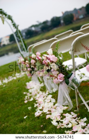 A tilt shot of an outdoor wedding aisle.