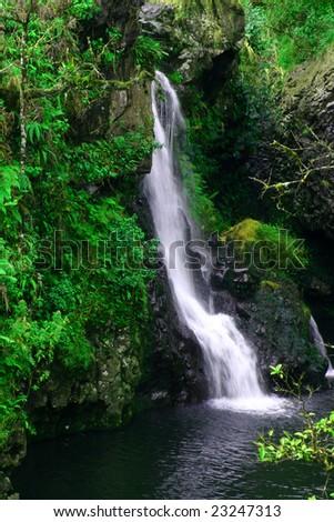 A time exposure of a waterfall along the historic Road to Hana on Maui, Hawaii.