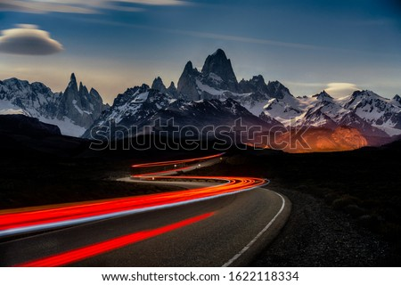 Photo of  A timelapse shot of car lights in Fitz Roy Mountains in Argentina