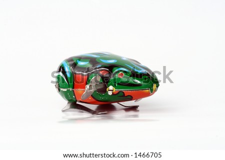a tin iron frog, against a white background