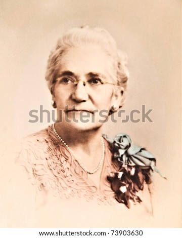 A tinted sepia photo of a grandmother circa 1940's.