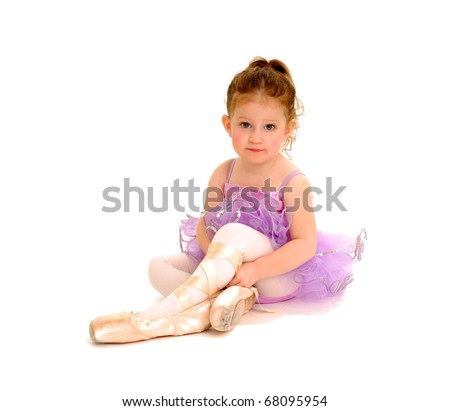 tiny ballerina tries on pointe shoes