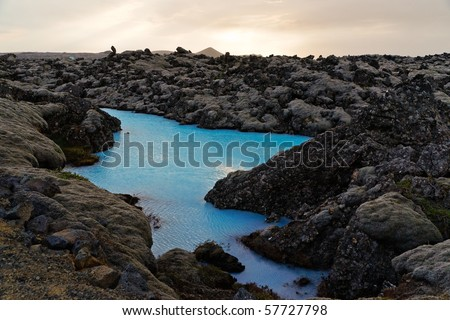 A tiny blue lake surrounded by black lava at the Blue Lagoon region near Reykjavik