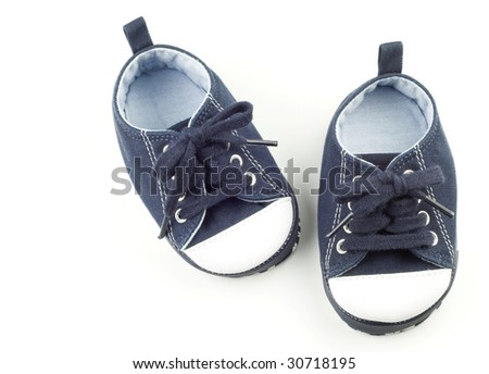 A tiny pair of blue infant shoes for a boy, isolated on white background with copy space