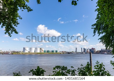 A tiny part of Hamburg's liquids harbour with rows of huge tanks for storing oil and other liquid chemicals. #1401681164