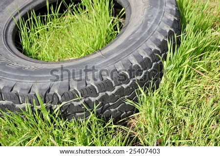 A tire is discarded improperly, spoiling the environment