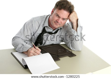 A tired, annoyed looking office worker. - stock photo