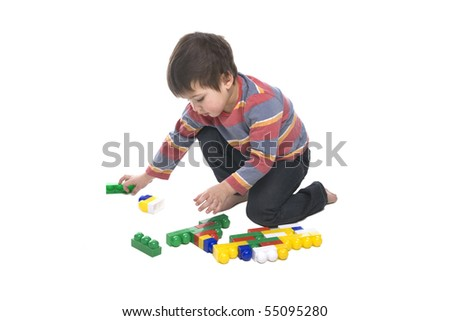 A toddler playing with a multicolored bricks