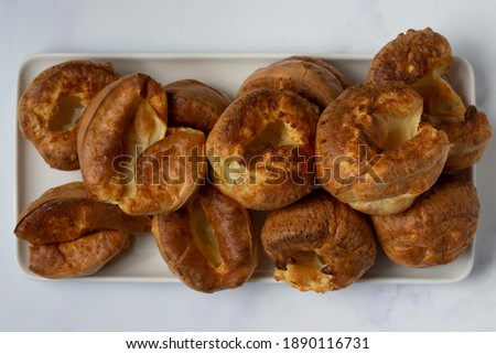 A top down view of Yorkshire puddings stacked on a white tray Stock photo ©