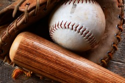 A top view image of old used baseball equipment.